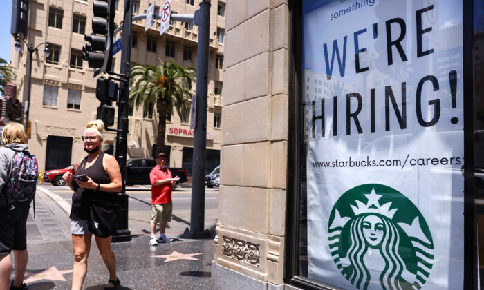A 'We're Hiring!' sign is displayed at a Starbucks on Hollywood Boulevard in Los Angeles, Calif., on June 23, 2021. (Mario Tama/Getty Images)