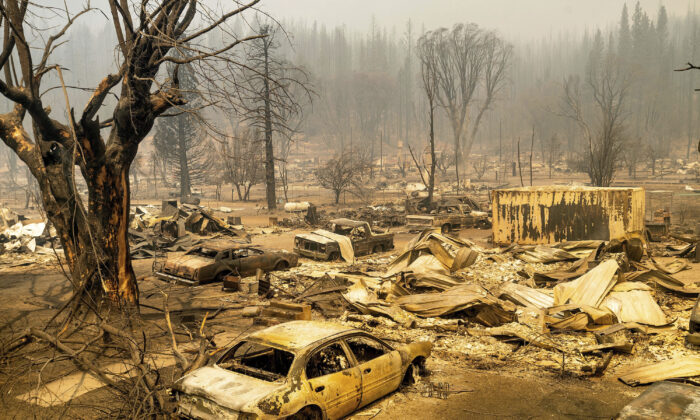 This photo shows cars and homes destroyed by the Dixie Fire line central Greenville in Plumas County, Calif., on Aug. 5, 2021. (Noah Berger/AP Photo)