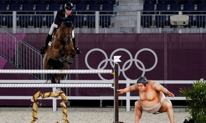 Britain's Harry Charles, riding Romeo 88, competes during the equestrian jumping individual qualifying at Equestrian Park in Tokyo at the 2020 Summer Olympics, Tuesday, in Tokyo, Japan on Aug. 3, 2021. (Carolyn Kaster/AP Photo)