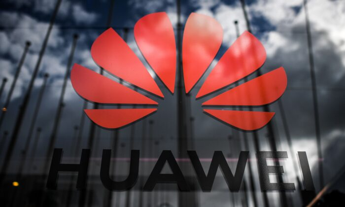 The logo of Chinese telecom giant Huawei is pictured during the Web Summit in Lisbon on Nov. 6, 2019. (Patricia De Melo Moreira/AFP via Getty Images)