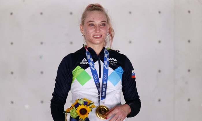 Janja Garnbret of Team Slovenia poses with the gold medal for Sport Climbing Women's Combined after  during the Sport Climbing Women's Combined Final on day fourteen of the Tokyo 2020 Olympic Games at Aomi Urban Sports Park in Tokyo, Japan on Aug. 6, 2021. (Maja Hitij/Getty Images)