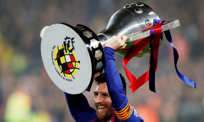 Barcelona's Lionel Messi celebrates winning La Liga with the trophy at Camp Nou, in Barcelona, Spain on April 27, 2019. (Albert Gea/Reuters)