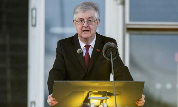 First Minister Mark Drakeford speaking at a National Coronavirus Commemorative Event outside the Senedd in Cardiff Bay, Wales, on March 23, 2021. (Matthew Horwood/Handout/Welsh government via PA)