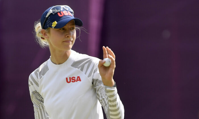 Nelly Korda of the United States gestures as she finishes her round 3 of the women's golf individual stroke play during the Tokyo 2020 Olympic Games at the Kasumigaseki Country Club in Kawagoe, Japan, on Aug. 6, 2021. (Toby Melville/Reuters)