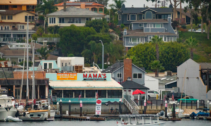 A view of a portion of the Mariner's Mile from the Newport Beach Harbor, in Newport Beach, Calif., on Aug. 8, 2020. (John Fredricks/The Epoch Times)