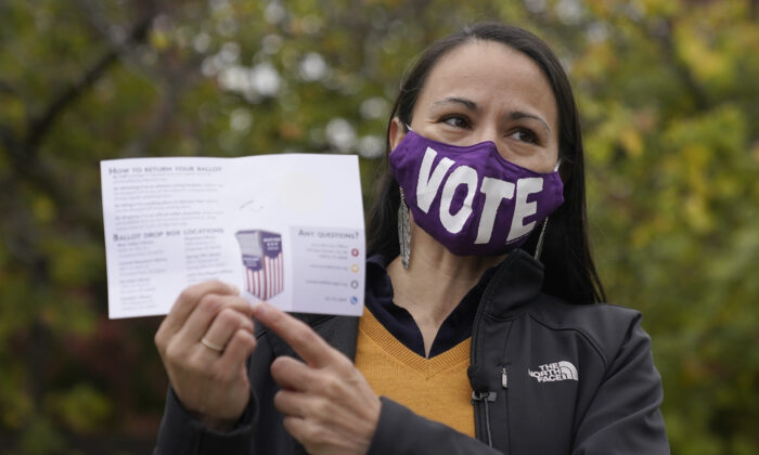 Rep. Sharice Davids (D-Kan.) talks to the media after depositing her advance ballot in Mission, Kan., on Oct. 20, 2020. (Charlie Riedel/AP Photo)
