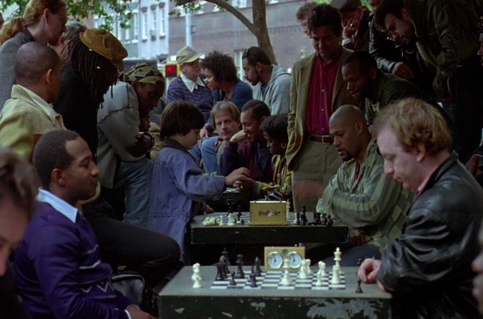 a young boy plays a chess hustler in SEARCHING FOR BOBBY FISCHER