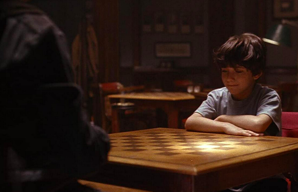 chess master teaches pupil in SEARCHING FOR BOBBY FISCHER