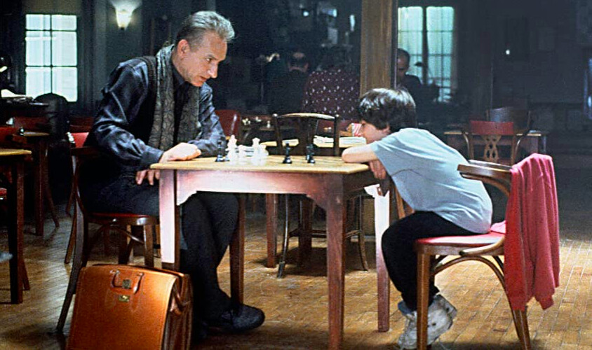 Mand and boy play chess in SEARCHING FOR BOBBY FISCHER