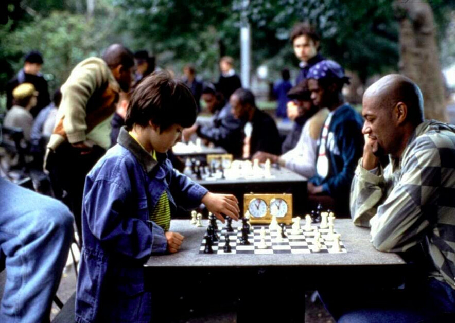 boy and man play chess in SEARCHING FOR BOBBY FISCHER
