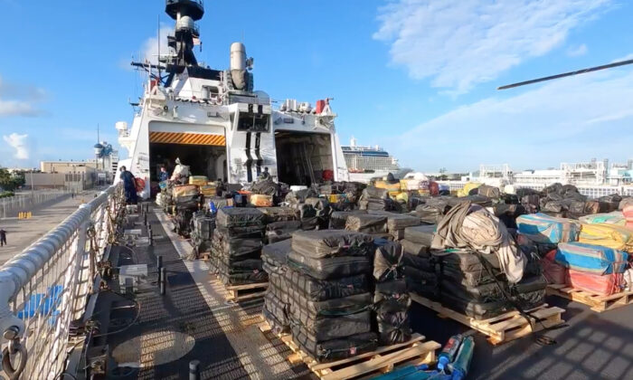 Bales of illicit cocaine and marijuana aboard U.S. Coast Guard Cutter James. (Screenshot/U.S. Coast Guard)