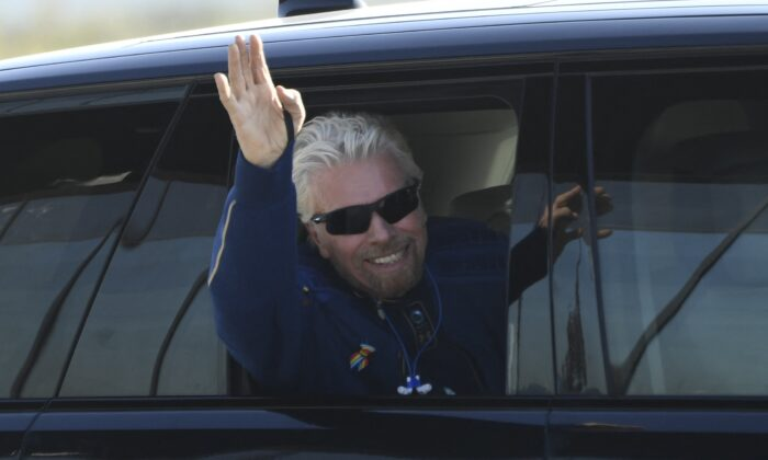 British billionaire Richard Branson is welcomed as he arrives at Spaceport America near Truth or Consequences, New Mexico, hours before travel to the cosmos aboard a Virgin Galactic space vessel, on  July 11, 2021. (Patrick T. Fallon/AFP via Getty Images)