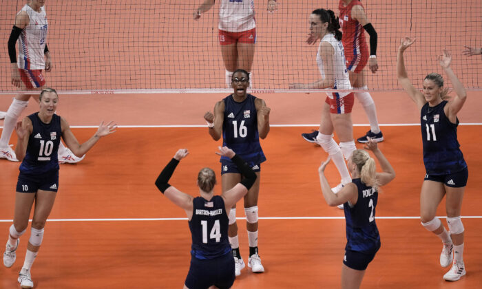 U.S. players celebrate winning a point during the women's volleyball semifinal match between Serbia and the United States at the 2020 Summer Olympics, in Tokyo, Japan, on Aug. 6, 2021. (Manu Fernandez/AP Photo)