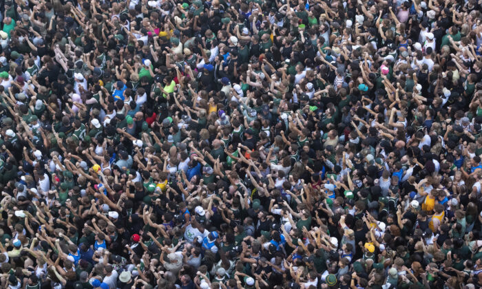 Fans pack the Deer District during game six of the 2021 NBA Finals at Fiserv Forum in Milwaukee, Wis., on July 20, 2021. (Mark Hoffman/Milwaukee Journal Sentinel-USA Today Sports)
