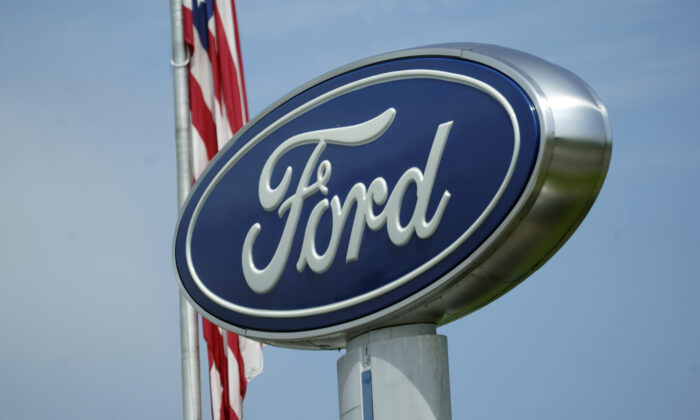 A Ford logo is seen on signage at Country Ford in Graham, N.C., on July 27, 2021. (Gerry Broome/AP Photo)