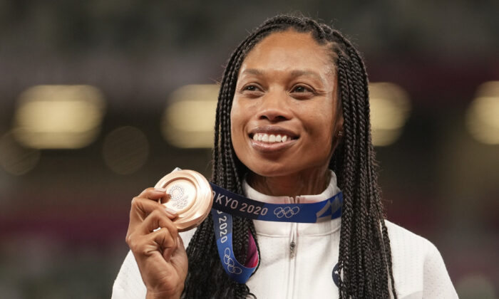 Bronze medalist Allyson Felix of the United States poses during the medal ceremony for the women's 400-meter run at the 2020 Summer Olympics in Tokyo, Japan, on Aug. 6, 2021. (Martin Meissner/AP Photo)