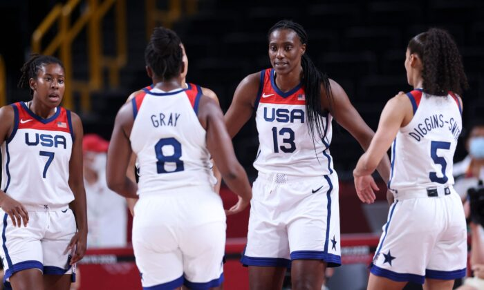 (From L) USA's Ariel Atkins, Chelsea Gray, Sylvia Fowles and Skylar Diggins react during the women's semi-final basketball match between USA and Serbia during the Tokyo 2020 Olympic Games at the Saitama Super Arena in Saitama, Japan, on Aug. 6, 2021. (Thomas Coex/AFP via Getty Images)
