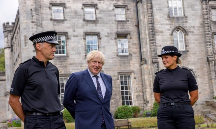 Britain's Prime Minister Boris Johnson meets officers during a visit to the Scottish Police College at Tulliallan near Kincardine, Scotland, on August 4, 2021. (James Glossop/Pool via Reuters)