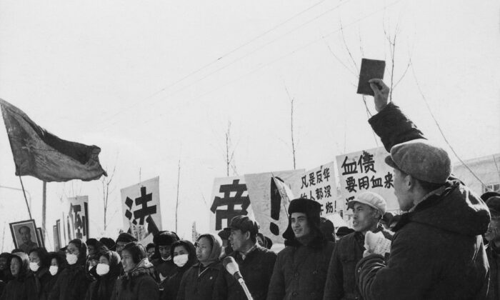 """Chinese people demonstrate during the """"great proletarian Cultural Revolution"""" in front of the French embassy in Beijing on January 1967. Protesters show symbols of the Revolution such as the portrait of Mao Zedong, banners, and the book """"Quotations from Chairman Mao Tse-tung."""" Since the cultural revolution was launched in May 1966 at Beijing University, Mao's aim was to recapture power after the failure of the """"Great Leap Forward."""" The movement was directed against those """"Party leaders in authority taking the capitalist road."""" (Jean Vincent/AFP via Getty Images)"""