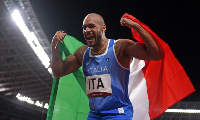Lamont Jacobs of Italy celebrates after taking the gold medal in the final of the men's 4 x 100-meter relay at the 2020 Summer Olympics in Tokyo, Japan, on Aug. 6, 2021. (Charlie Riedel/AP Photo)