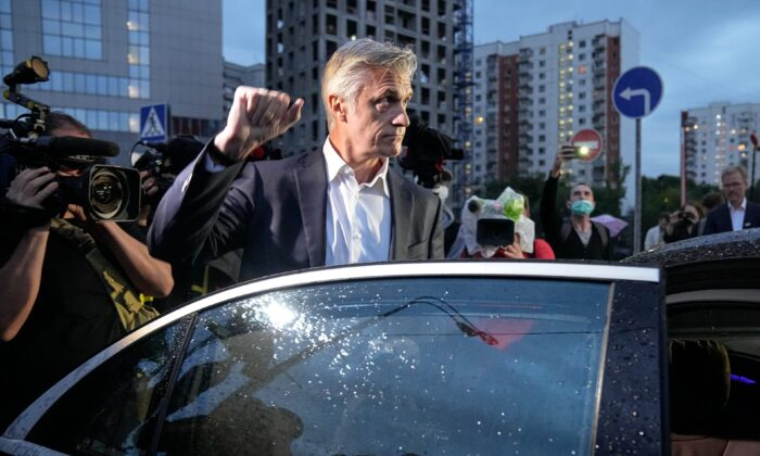 Founder of the Baring Vostok investment fund Michael Calvey speaks to journalists as he leaves a court room after a hearing in Moscow, Russia, on Aug. 5, 2021. (Alexander Zemlianichenko /AP Photo)