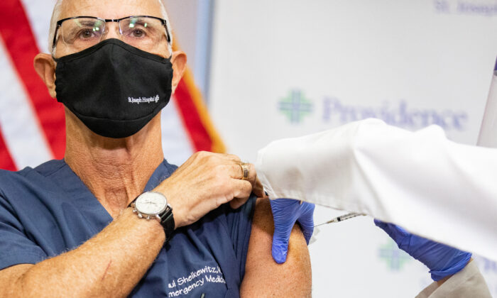 The first doctor to receive the Coronavirus vaccination was Paul Sheikewitz MD at St. Joseph Hospital on Dec. 16, 2020. (John Fredricks/The Epoch Times)
