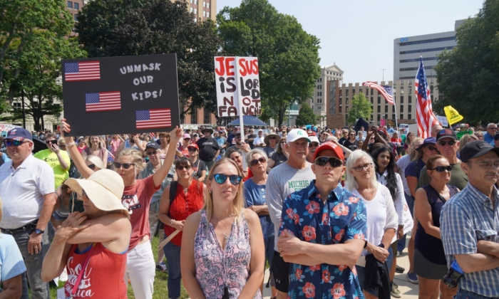 A view of part of the crowd protesting mandatory vaccinations and mask mandates at a rally at the State Capitol grounds in Lansing, Mich., on Aug. 6, 2021. (Steven Kovac/Epoch Times)