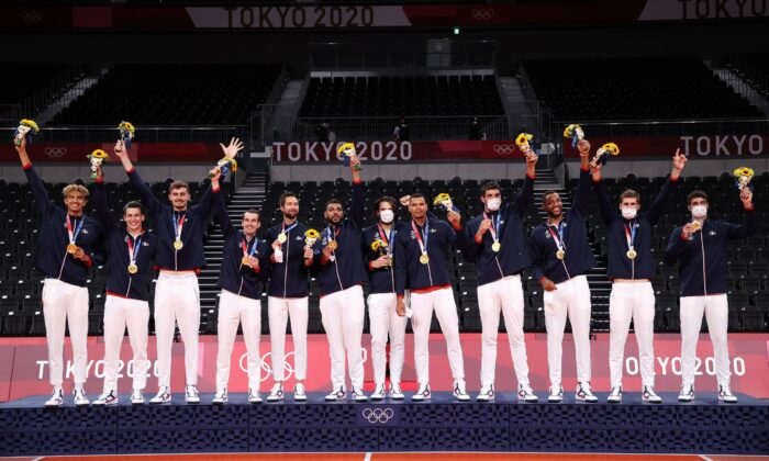 Players of Team France pose with their Gold Medals during the Victory Ceremony following the Men's Gold Medal Volleyball match between France and ROC on day fifteen of the Tokyo 2020 Olympic Games at Ariake Arena in Tokyo, Japan, on Aug. 7, 2021. (Toru Hanai/Getty Images)