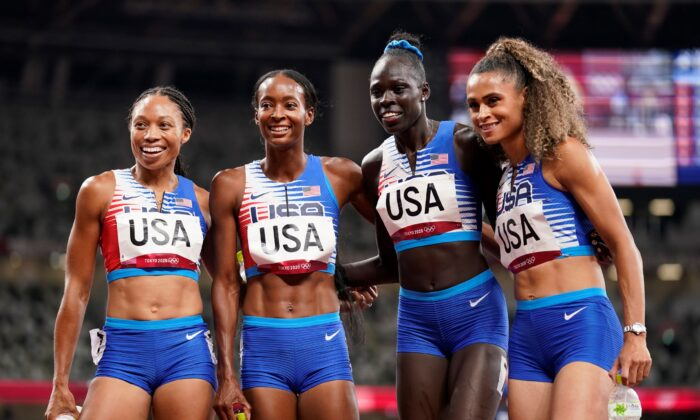 (L–R) The United States team of Allyson Felix, Dalilah Muhammad, Athing Mu, and Sydney Mclaughlin, celebrate winning the gold medal in the final of the women's 4 x 400-meter relay at the 2020 Summer Olympics, in Tokyo, Japan, on Aug. 7, 2021. (Charlie Riedel/AP Photo)