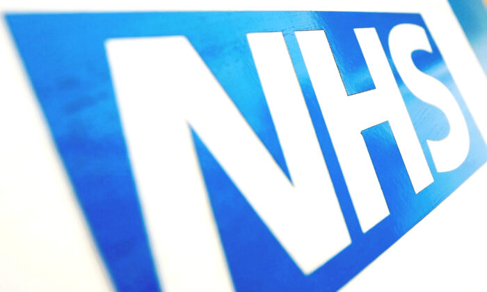 An NHS logo taken on June 11, 2010. (Dominic Lipinski/PA)