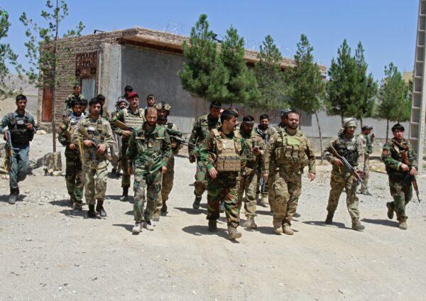 Afghan security personnel patrol