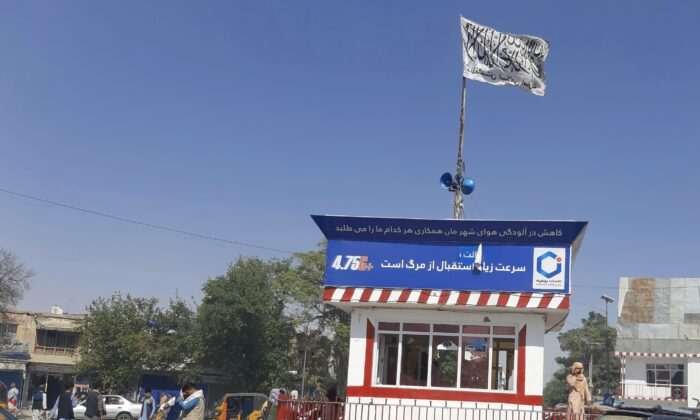 Taliban flag flies on the main square of Kunduz city after fighting between Taliban and Afghan security forces in Kunduz city, north of Kabul, Afghanistan, on Aug. 8, 2021. (Abdullah Sahil/AP Photo)