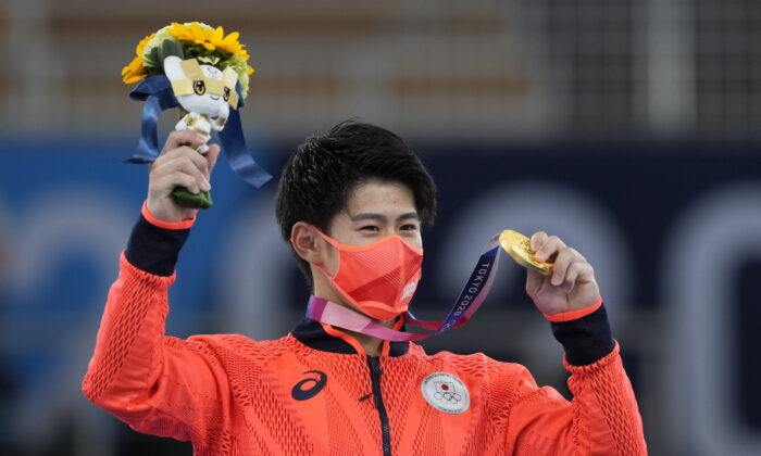Daiki Hashimoto of Japan poses with his gold medal for the artistic gymnastics men's all-around final at the 2020 Summer Olympics, in Tokyo, on July 28, 2021. (Natacha Pisarenko/AP Photo)