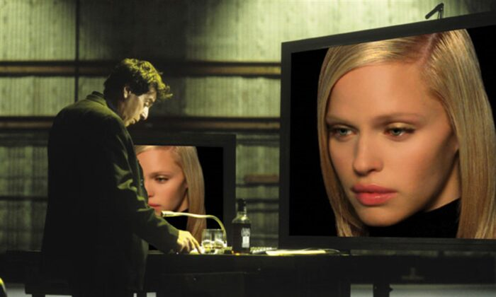 "Movie director Viktor Taransky (Al Pacino) fiddling with his simulated ""actress"" in ""Simone."" (New Line Cinema)"
