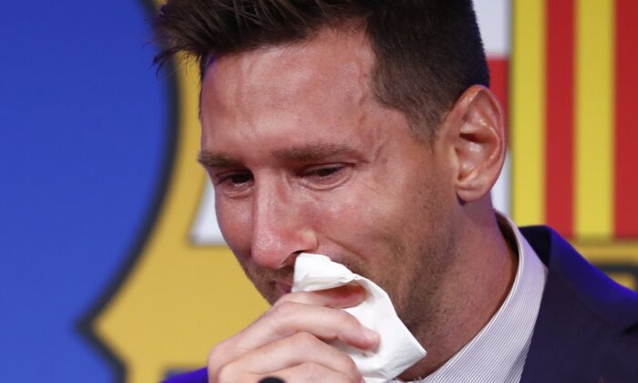 Lionel Messi cries at the start of a press conference at the Camp Nou stadium in Barcelona, Spain, on Aug. 8, 2021. (Joan Monfort/AP Photo)