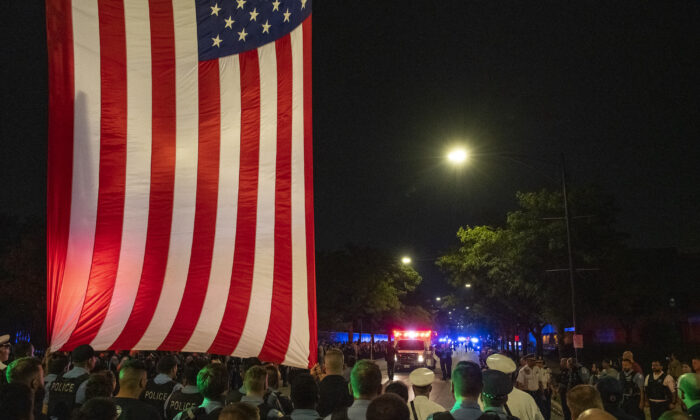 A Chicago police procession for a police officer who was shot and killed earlier during a traffic stop at 63rd and Bell drives by the Cook County Medical Examiners Office in Chicago, Ill., on Aug. 8, 2021. (Tyler LaRiviere/Sun-Times)