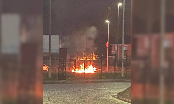 Damage caused after a gang of up to 30 people, including masked men, threw masonry and petrol bombs during a night of disorder in Co. Tyrone, Northern Ireland, on Aug. 7, 2021. (Police Service Northern Ireland/Handout via PA)