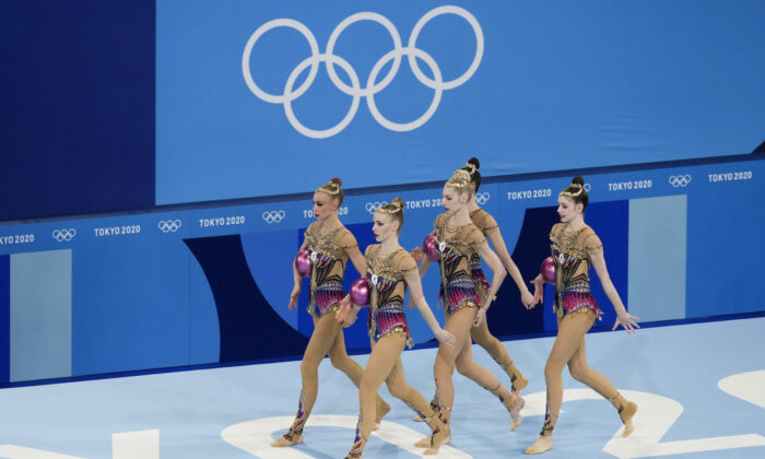 Russian Olympic Committee's rhythmic gymnastics' team performs during the group all-around final at the 2020 Summer Olympics, in Tokyo, Japan, on Aug. 8, 2021, . (Ashley Landis/AP Photo)
