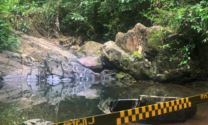 Police tape cordons off the area where a woman was found dead a day earlier at a secluded spot on the southern island of Phuket, Thailand on Aug. 6, 2021. (AP Photo)