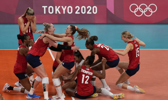 Players from the United States react after defeating Brazil to win the gold medal in women's volleyball at the 2020 Summer Olympics, in Tokyo, Japan, on Aug. 8, 2021. (Frank Augstein/AP Photo)