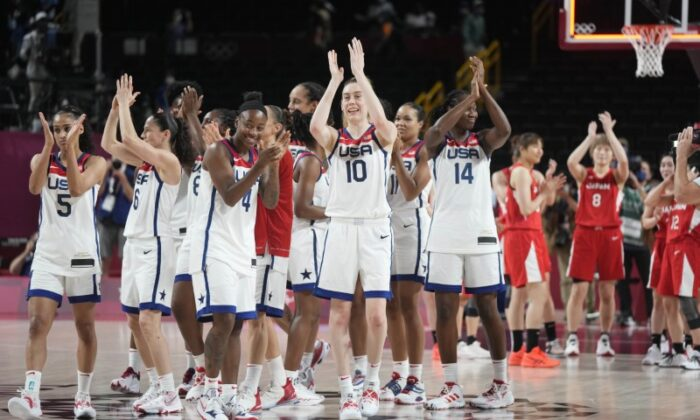 Team USA celebrates winning the gold medal against Japan in the women's basketball gold medal match during the Tokyo 2020 Olympic Summer Games at Saitama Super Arena in Saitama, Japan, on Aug. 8, 2021. (James Lang/USA TODAY Sports via Reuters)