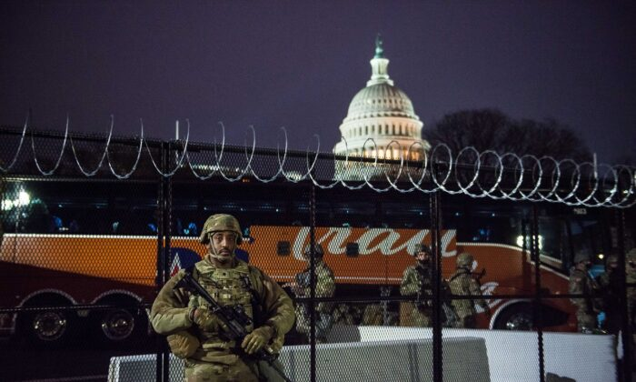A National Guard soldier stands outside the razor wire fencing that surrounds the U.S. Capitol in Washington on Jan. 15, 2021. (Liz Lynch/Getty Images)