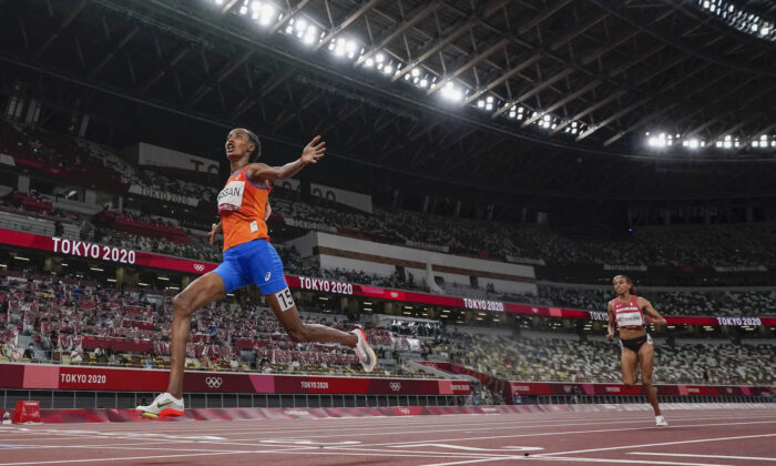 Sifan Hassan, of the Netherlands, wins the women's 10,000-meter run final at the 2020 Summer Olympics in Tokyo, Japan, Aug. 7, 2021. (David J. Phillip/AP Photo)