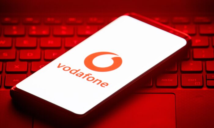 A Vodafone logo displayed on a mobile phone in a file photo. (Dominic Lipinski/PA)