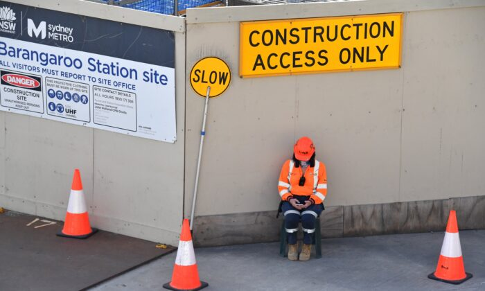 A construction worker is seen on a construction site at Barangaroo Point in Sydney, Australian, on Aug. 2, 2021. (AAP Image/Mick Tsikas)