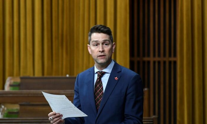 Parliamentary Secretary to Minister of Innovation, Science and Industry (Science) Will Amos rises during Question Period in the House of Commons on Parliament Hill in Ottawa on Nov. 27, 2020. (The Canadian Press/Justin Tang)