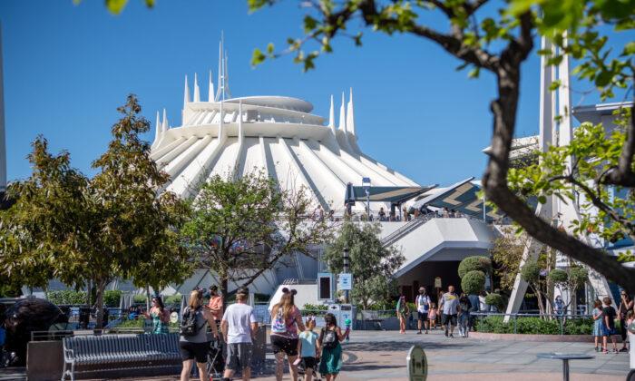 Guests arrive in Tomorrowland at the Disneyland Resort  in Anaheim, Calif., on April 30, 2021. (Richard Harbaugh/Disneyland Resort via Getty Images)