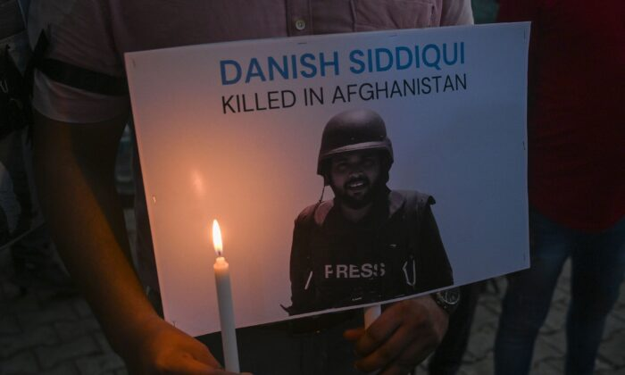 Media personnel pay homage to Reuters journalist Danish Siddiqui at the press club in New Delhi on July 17, 2021, after the Pulitzer Prize-winning photographer was killed covering fighting between Afghan security forces and the Taliban near a border crossing with Pakistan, the media outlet reported, citing an army commander. (Prakash Singh/AFP via Getty Images)