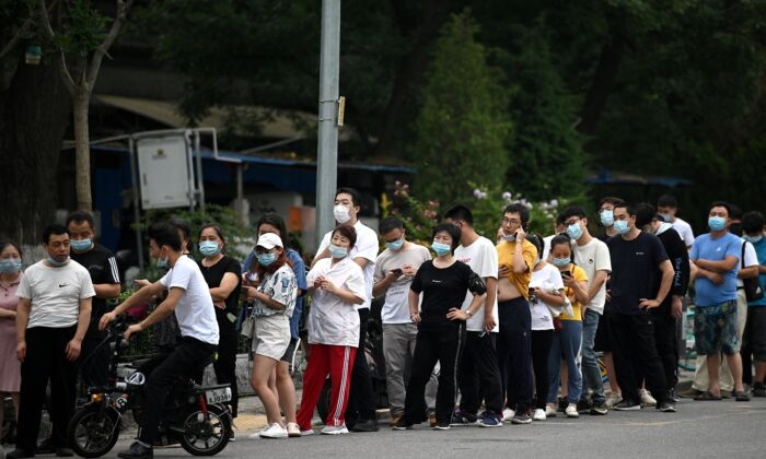 People queue to get tested for COVID-19 at a test site in Beijing, China on Aug. 5, 2021. (Noel Celis/AFP via Getty Images)