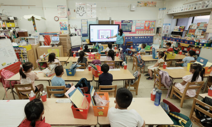 Melissa Moy, a teacher at Yung Wing School P.S. 124, goes over a lesson on a monitor during the in-person summer program for students in New York City, on July 22, 2021. (Michael Loccisano/Getty Images)